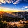 Sunrise-landscape-mountains-forest-pine-trees-sun-