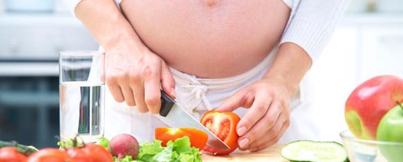 pregnant-woman-preparing-food.jpg